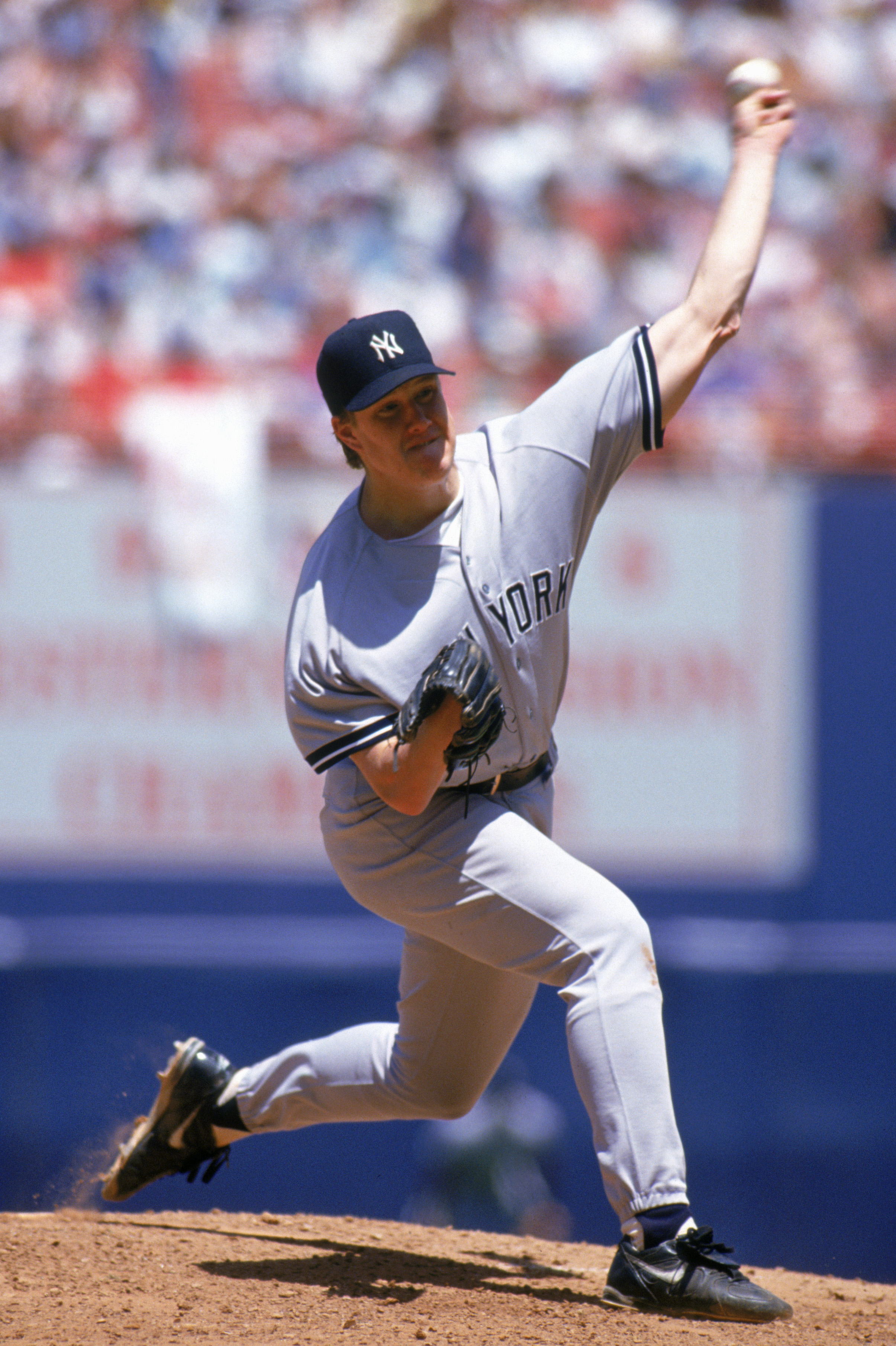 ANAHEIM, CA - JULY 11:  Jim Abbott #25 of the New York Yankees delivers a pitch during a game against the California Angels at Anaheim Stadium on July 11, 1993 in Anaheim, California.  (Photo by Jonathan Daniel/Getty Images)