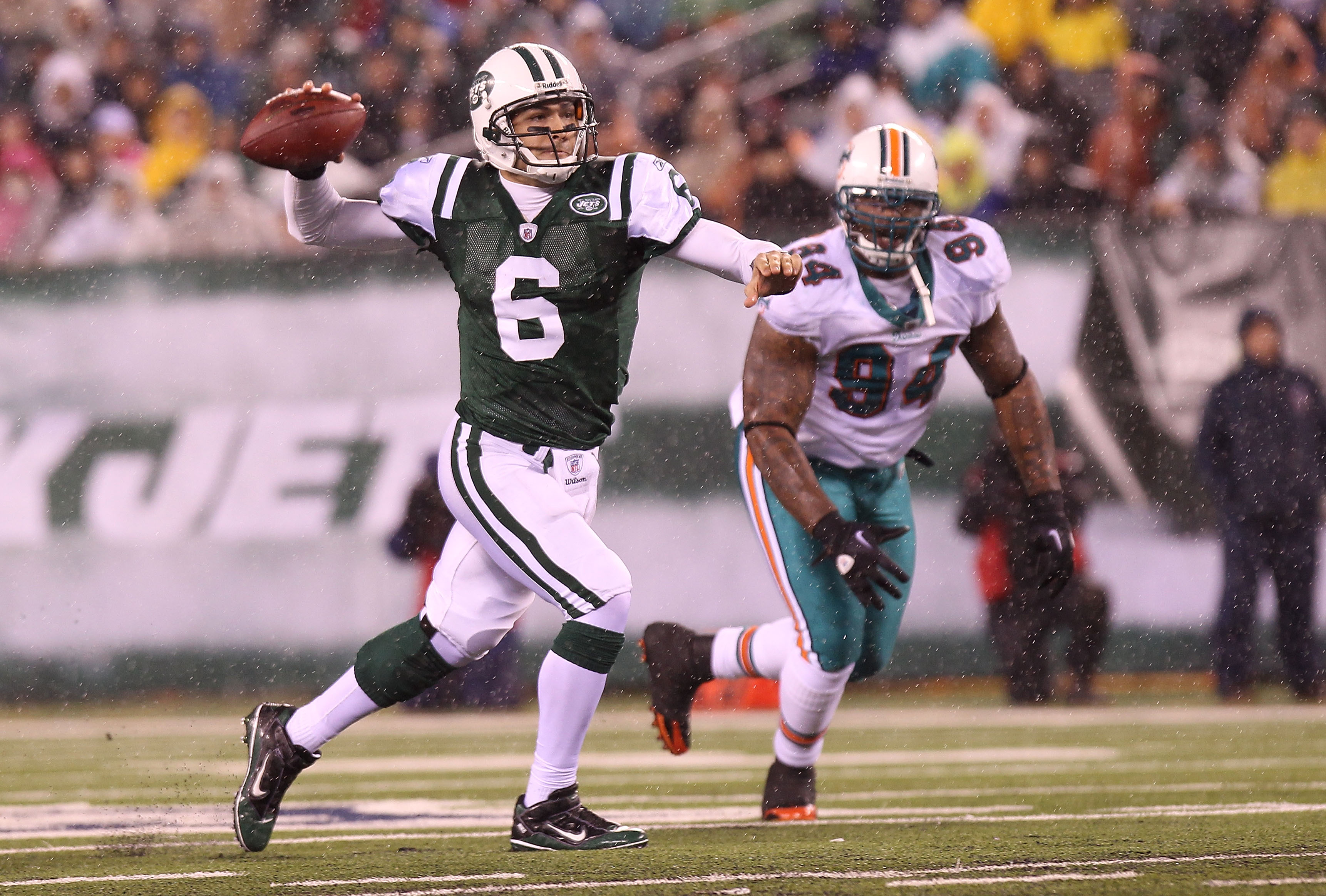 EAST RUTHERFORD, NJ - DECEMBER 12: Mark Sanchez #6 of the New York Jets opens up to pass against the Miami Dolphins at New Meadowlands Stadium on December 12, 2010 in East Rutherford, New Jersey.  (Photo by Nick Laham/Getty Images)