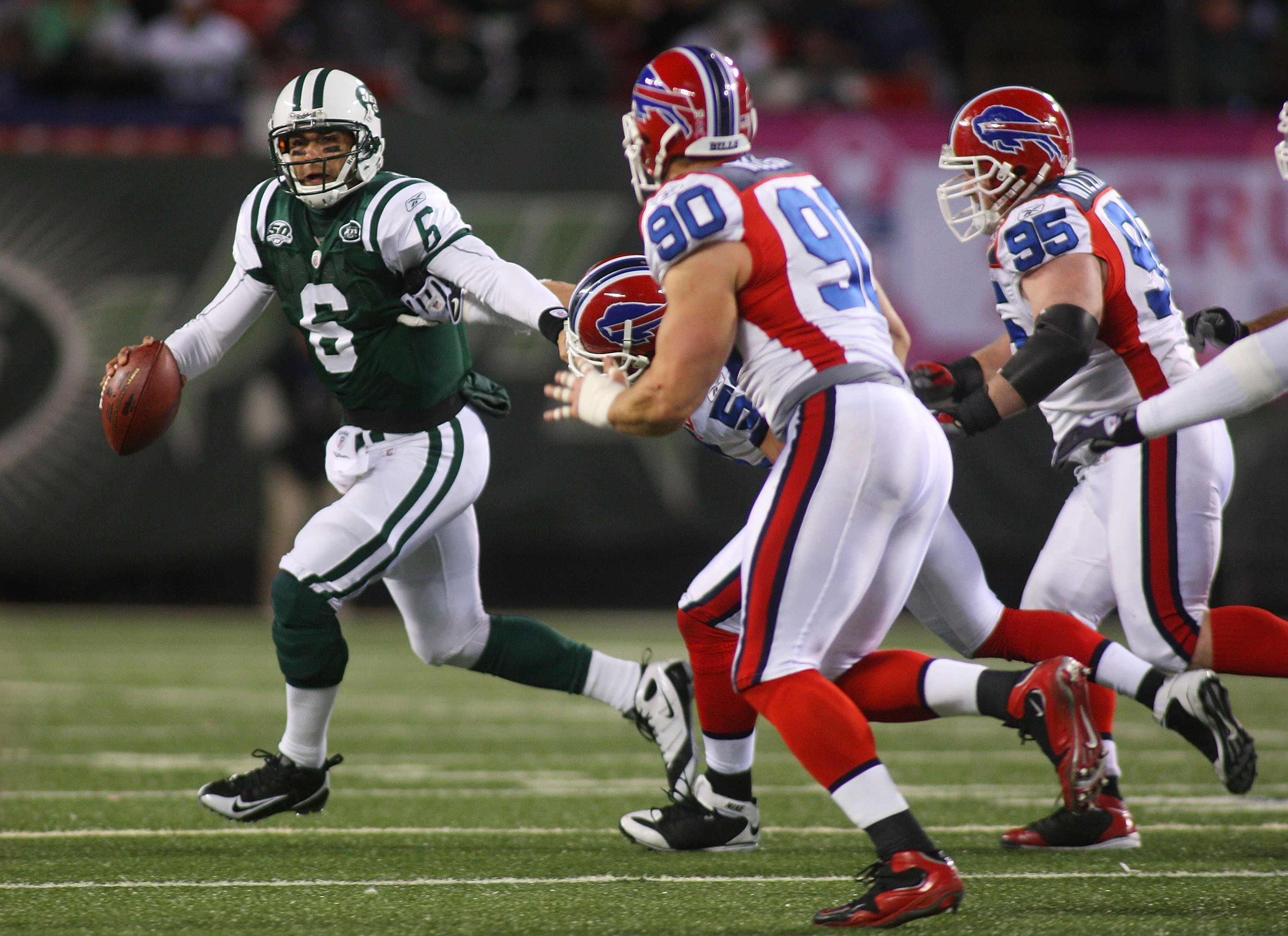 EAST RUTHERFORD, NJ - OCTOBER 18:  Ouaterback Mark Sanchez #6 of the New York Jets scrambles out of the pocket against the Buffalo Bills at Giants Stadium in the Meadowlands on October 18, 2009 in East Rutherford, New Jersey. The Bills defeated the Jets 1