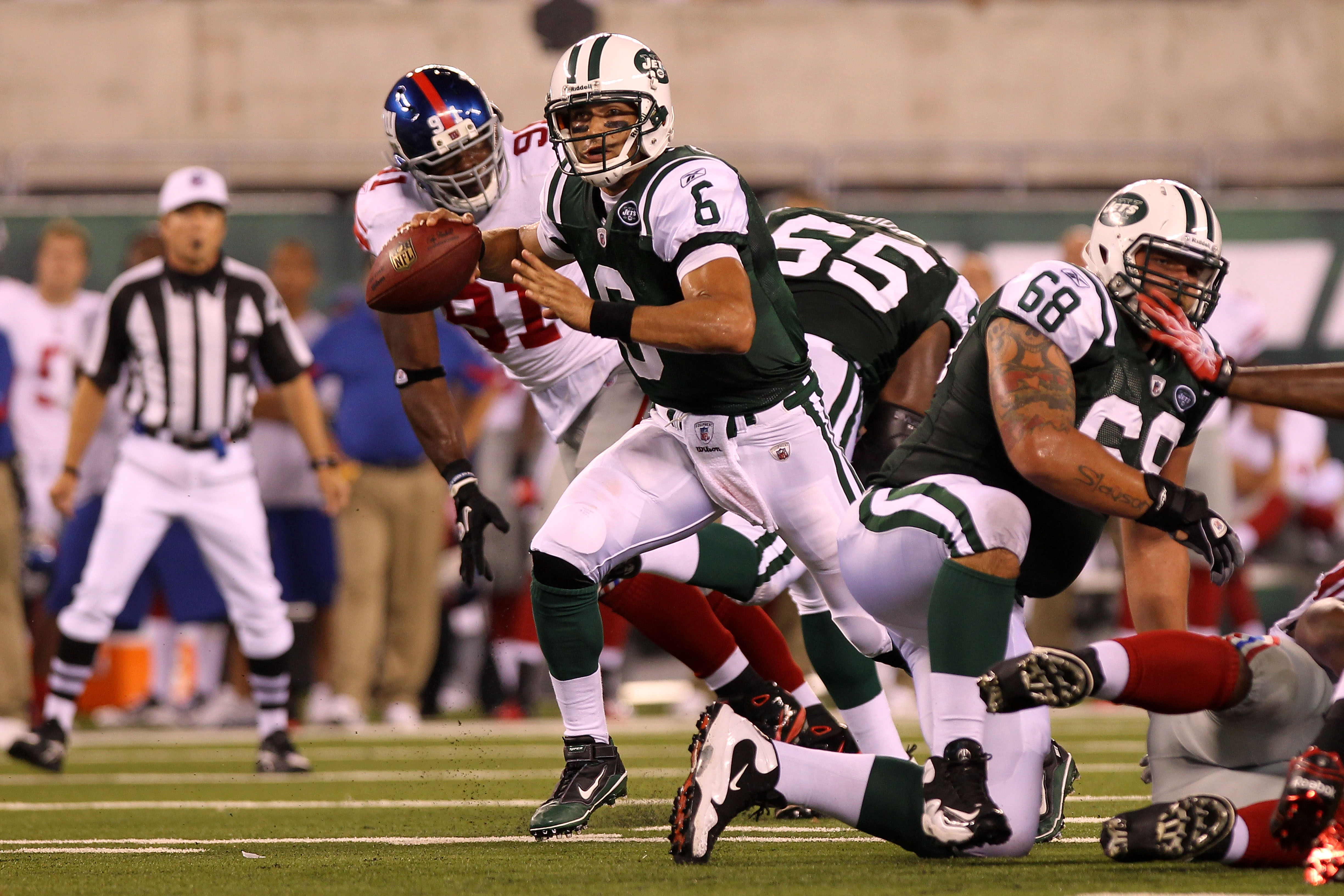EAST RUTHERFORD, NJ - AUGUST 16:  Quarterback Mark Sanchez #6 of the New York Jets scrambles against the New York Giants during their game at New Meadowlands Stadium on August 16, 2010 in East Rutherford, New Jersey.  (Photo by Nick Laham/Getty Images)