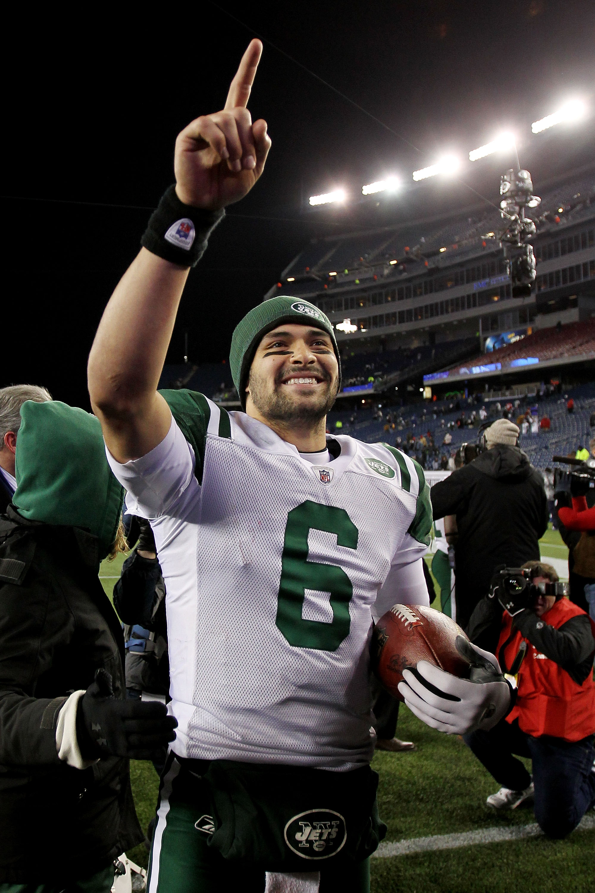 FOXBORO, MA - JANUARY 16:  Mark Sanchez #6 of the New York Jets celebrates after they defeated the Patriots 28 to 21 in their 2011 AFC divisional playoff game at Gillette Stadium on January 16, 2011 in Foxboro, Massachusetts.  (Photo by Jim Rogash/Getty I