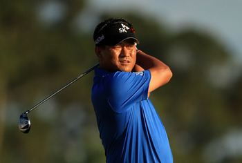 PONTE VEDRA BEACH, FL - MAY 15:  K.J. Choi of South Korea hits an approach shot on the 18th hole during the final round of THE PLAYERS Championship held at THE PLAYERS Stadium course at TPC Sawgrass on May 15, 2011 in Ponte Vedra Beach, Florida.  (Photo b