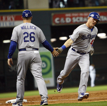 HOUSTON - MAY 24:  Jerry Sands #47 of the Los Angeles Dodgers is congratulated by third base coach Tim Wallach #26 after hitting a grand slam in the third inning against the Houston Astros at Minute Maid Park on May 24, 2011 in Houston, Texas.  (Photo by