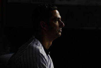 NEW YORK - MAY 20:  Jorge Posada #20 of the New York Yankees sits on the bench during the game against the New York Metson May 20, 2011 at Yankee Stadium in the Bronx borough of New York City. Mets defeat the Yankees 2-1.  (Photo by Mike Stobe/Getty Image