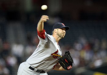 PHOENIX, AZ - APRIL 12:  Starting pitcher Chris Carpenter #29 of the St. Louis Cardinals pitches against the Arizona Diamondbacks during the Major League Baseball game at Chase Field on April 12, 2011 in Phoenix, Arizona.  (Photo by Christian Petersen/Get