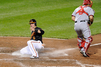 BALTIMORE, MD - MAY 20:  Ryan Adams #6 of the Baltimore Orioles scores in the fourth inning against the Washington Nationals at Oriole Park at Camden Yards on May 20, 2011 in Baltimore, Maryland. Adams made his major league debut tonight.  (Photo by Greg