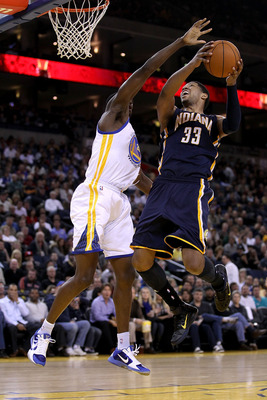 OAKLAND, CA - JANUARY 19:  Danny Granger #33 of the Indiana Pacers goes up for a shot on Ekpe Udoh #20 of the Golden State Warriors at Oracle Arena on January 19, 2011 in Oakland, California.  NOTE TO USER: User expressly acknowledges and agrees that, by