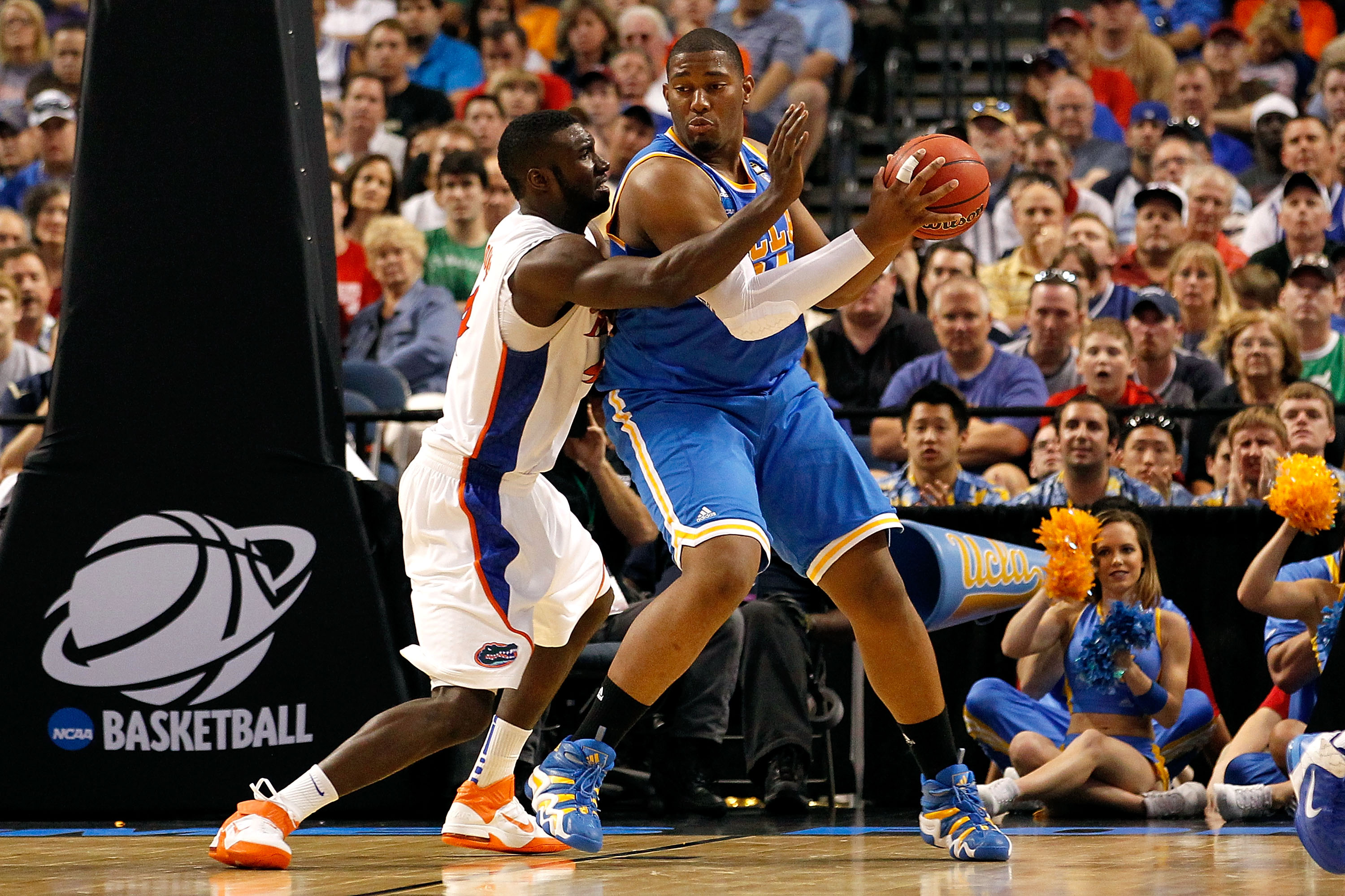 TAMPA, FL - MARCH 19:  Joshua Smith #34 of the UCLA Bruins posts up against Patric Young #4 of the Florida Gators during the third round of the 2011 NCAA men's basketball tournament at St. Pete Times Forum on March 19, 2011 in Tampa, Florida. Florida won
