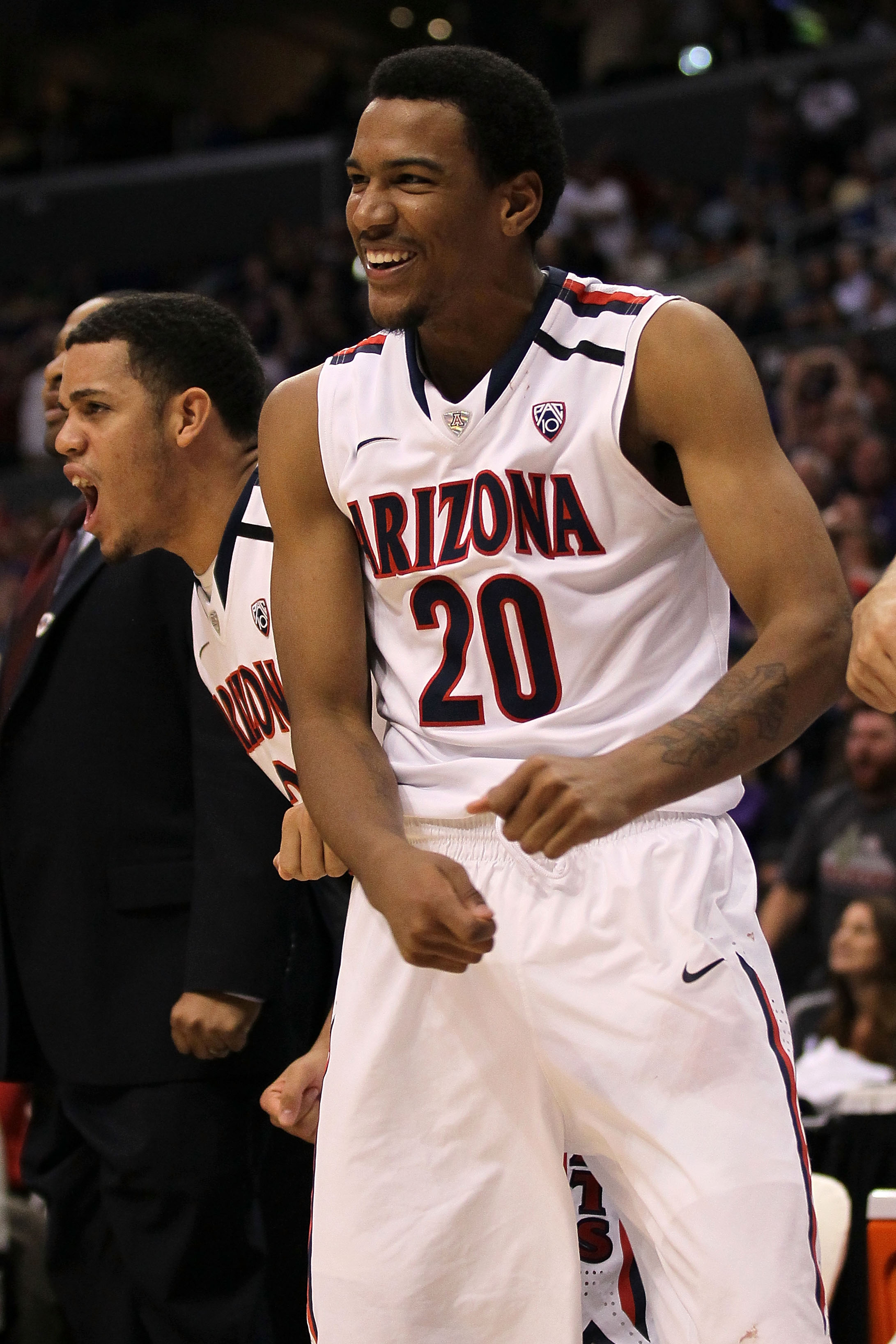 LOS ANGELES, CA - MARCH 12:  Jordin Mayes #20 of the Arizona Wildcats reacts from the bench while taking on the Washington Huskies in the championship game of the 2011 Pacific Life Pac-10 Men's Basketball Tournament at Staples Center on March 12, 2011 in