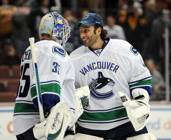 ANAHEIM, CA - MARCH 06:  Cory Schneider #35 of the Vancouver Canucks celebrates his 3-0 shutout of the Anaheim Ducks with goalie Roberto Luongo #1 at the end of the game at the Honda Center on March 6, 2011 in Anaheim, California.  (Photo by Harry How/Get