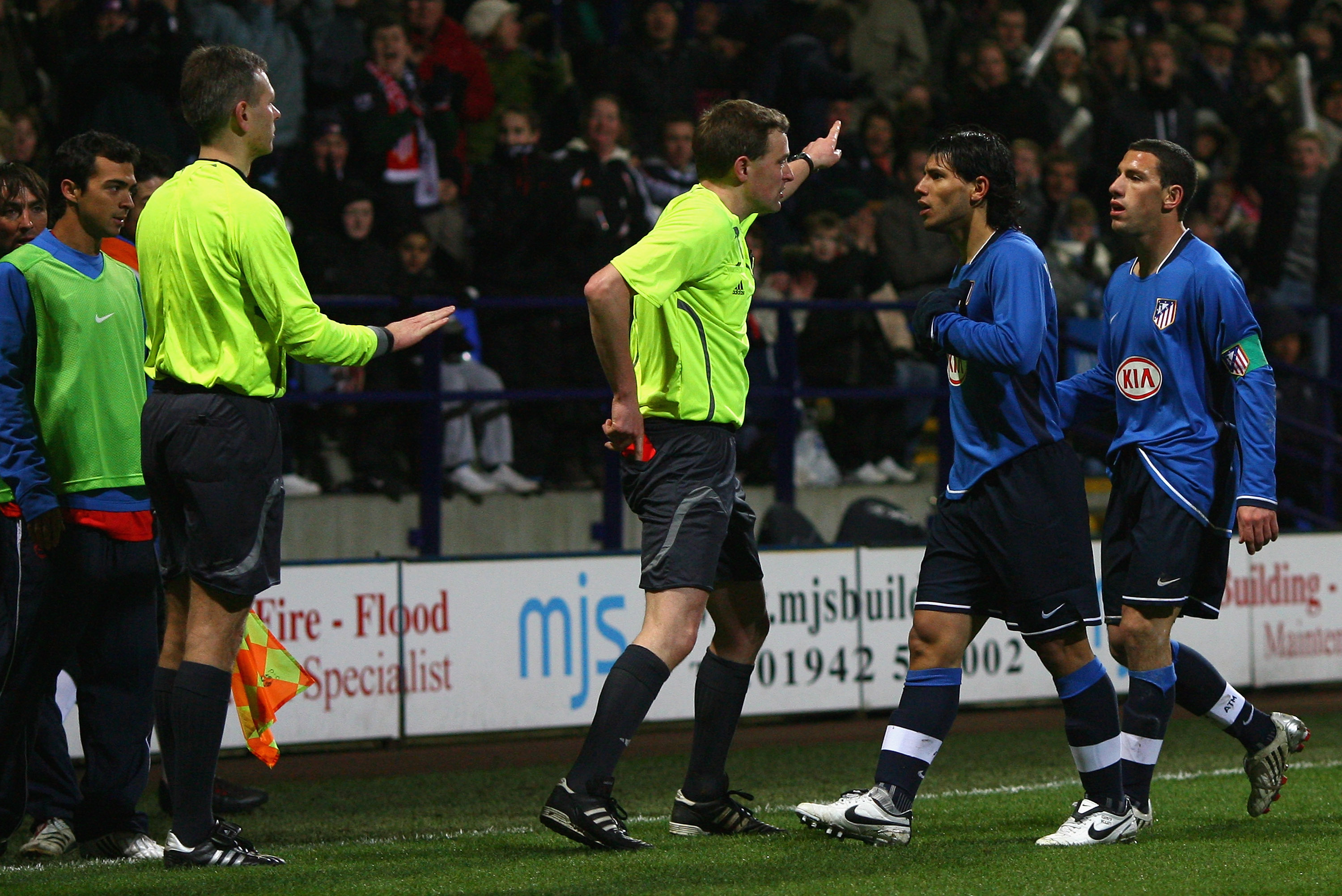 BOLTON, UNITED KINGDOM - FEBRUARY 14: Referee N Vollquartz shows a red card to Sergio Aguero of Atletico Madrid during the UEFA Cup Round of 32, First Leg match between Bolton Wanderers and Atletico Madrid at The Reebok Stadium on February 14, 2008 in Bol