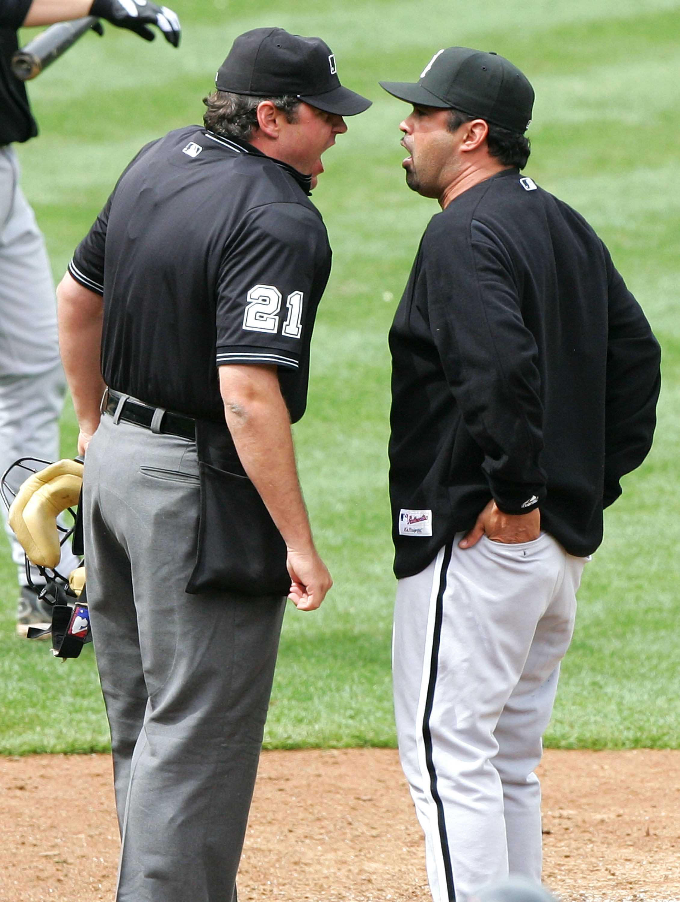 OAKLAND, CA - APRIL 27:  Umpire Hunter Wendelstedt #21 (L) and Ozzie Guillen #13, manager of the Chicago White Sox, argue during the game between the Sox and the Oakland Athletics on April 27, 2005 at McAfee Coliseum in Oakland, California.  (Photo by Jed