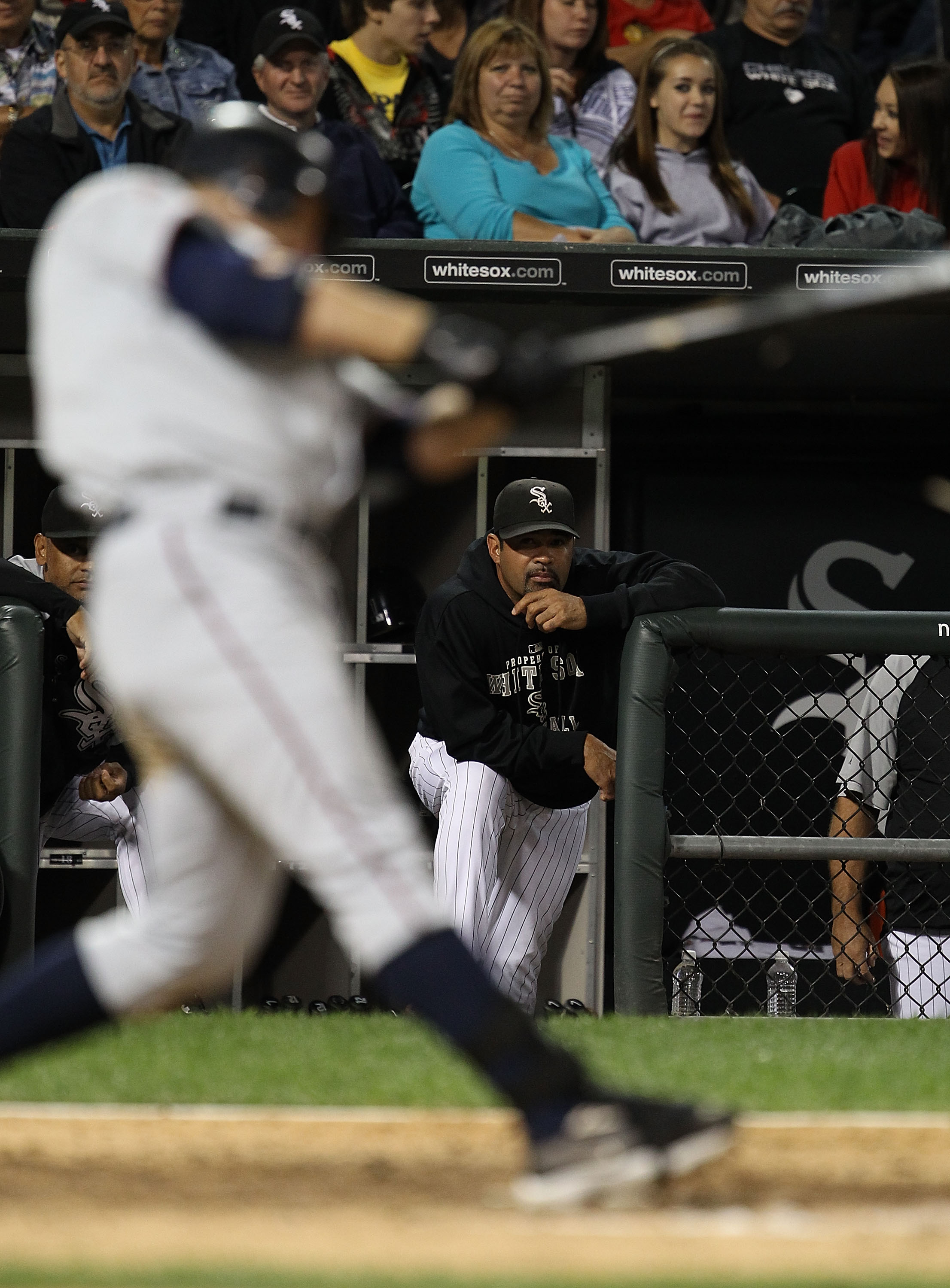 CHICAGO - SEPTEMBER 14: Manager Ozzie Guillen #13 of the Chicago White Sox watches as Jim Thome #25 of the Minnesota Twins takes a swing at U.S. Cellular Field on September 14, 2010 in Chicago, Illinois. (Photo by Jonathan Daniel/Getty Images)