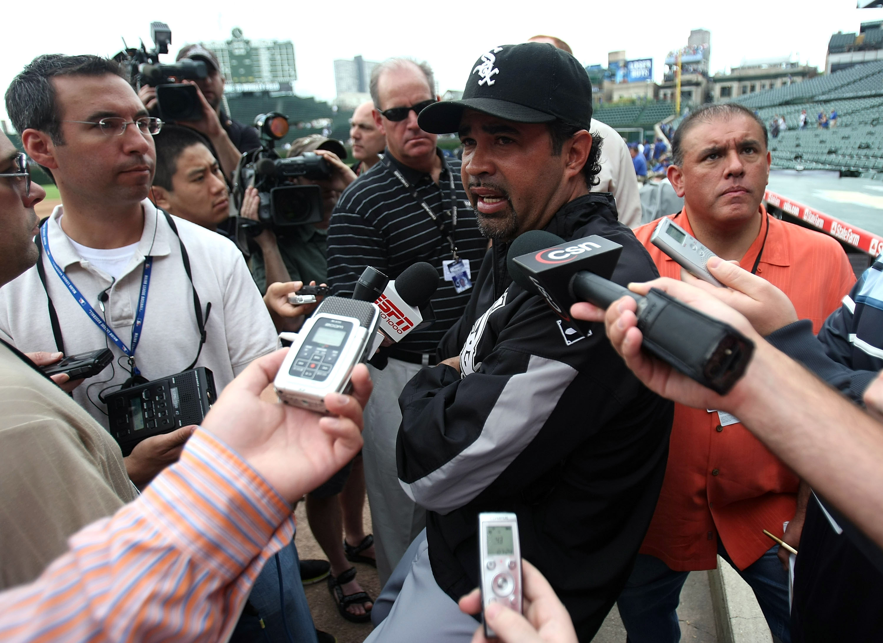 CHICAGO - JUNE 20: Manager Ozzie Guillen #13 of the Chicago White Sox talks to media members before a game against the Chicago Cubs on June 20, 2008 at Wrigley Field in Chicago, Illinois. (Photo by Jonathan Daniel/Getty Images)