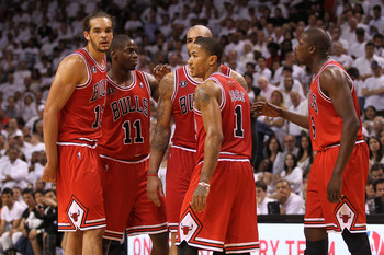 MIAMI, FL - MAY 24: (L-R) Joakim Noah #13, Ronnie Brewer #11, Carlos Boozer #5, Derrick Rose #1 and Luol Deng #9 of the Chicago Bulls look on against the Miami Heat in Game Four of the Eastern Conference Finals during the 2011 NBA Playoffs on May 24, 2011