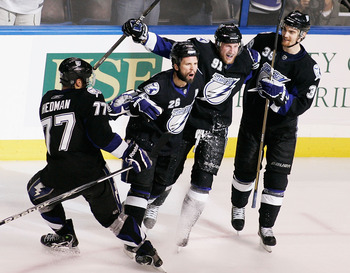 TAMPA, FL - MAY 25:  Martin St. Louis #26 of the Tampa Bay Lightning celebrates his second period goal with teammates in Game Six of the Eastern Conference Finals against the Boston Bruins during the 2011 NHL Stanley Cup Playoffs at St Pete Times Forum on