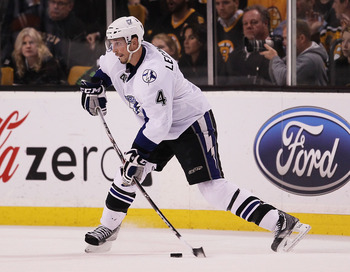 BOSTON, MA - MAY 23:  Vincent Lecavalier #4 of the Tampa Bay Lightning controls the puck in Game Five of the Eastern Conference Finals against the Boston Bruins during the 2011 NHL Stanley Cup Playoffs at TD Garden on May 23, 2011 in Boston, Massachusetts