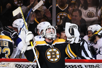 BOSTON, MA - MAY 23:  Tim Thomas #30 of the Boston Bruins celebrates their 3 to 1 victory over the Tampa Bay Lightning in Game Five of the Eastern Conference Finals during the 2011 NHL Stanley Cup Playoffs at TD Garden on May 23, 2011 in Boston, Massachus
