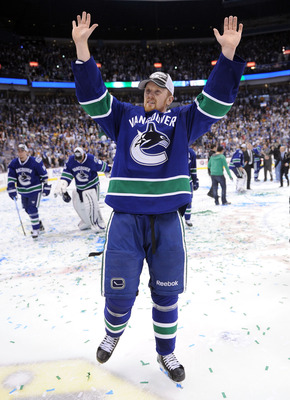 VANCOUVER, CANADA - MAY 24:  Henrik Sedin #33 of the Vancouver Canucks celebrates after defeating the San Jose Sharks 3-2 in double-overtime in Game Five to win the Western Conference Finals during the 2011 Stanley Cup Playoffs at Rogers Arena on May 24,