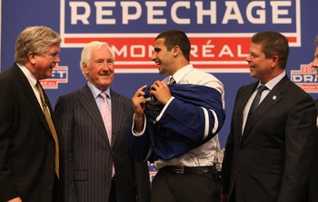 MONTREAL - JUNE 26:  (L-R)  Toronto Maple Leafs President & GM Brian Burke, Special Advisor Cliff Fletcher, First Round Draft Pick Nazem Kadri and Senior VP of Hockey Operations Dave Nonis stand on the stage during the first round of the 2009 NHL Entry Dr