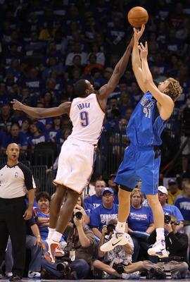 OKLAHOMA CITY, OK - MAY 21:  Dirk Nowitzki #41 of the Dallas Mavericks shoots over Serge Ibaka #9 of the Oklahoma City Thunder in Game Three of the Western Conference Finals during the 2011 NBA Playoffs at Oklahoma City Arena on May 21, 2011 in Oklahoma C