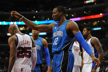 LOS ANGELES, CA - DECEMBER 08:  Dwight Howard #12 of the Orlando Magic reacts to a foul called against the Los Angeles Clippers during the first quarter at the Staples Center on December 8, 2008 in Los Angeles, California.   The Magic won 95-88.  NOTE TO