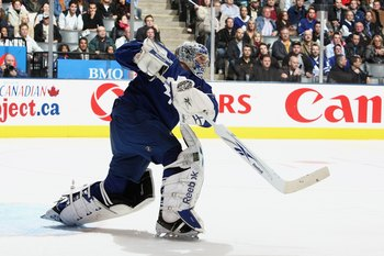 TORONTO - MARCH 28:  Goalie Justin Pogge #1 of the Toronto Maple Leafs passes the puck against the Boston Bruins during the NHL game at the Air Canada Centre on March 28, 2009 in Toronto, Ontario. (Photo by: Dave Sandford/Getty Images)