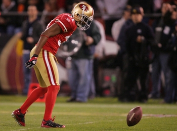 SAN FRANCISCO - DECEMBER 14:  Cornerback Dre' Bly #31 of the San Francisco 49ers spins the ball on the field after defending a pass against the Arizona Cardinals at Candlestick Park on December 14, 2009 in San Francisco, California. (Photo by Ezra Shaw/Ge