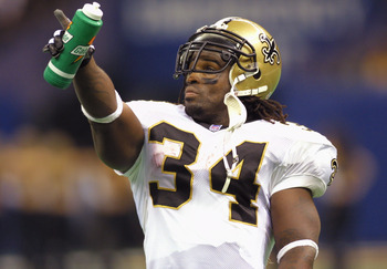 7 Oct 2001: Ricky Williams #34 of the New Orleans Saints points to the scoreboard during the game against the Minnesota Vikings at the Superdome in New Orleans, Louisiana. The Saints won 28-15. DIGITAL IMAGE. Mandatory Credit: Ronald Martinez/ALLSPORT