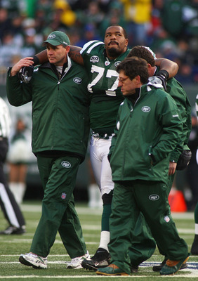 EAST RUTHERFORD, NJ - OCTOBER 18:  Kris Jenkins #77 of the New York Jets is helped off the field after being injured in the second quarter against the Buffalo Bills at Giants Stadium in the Meadowlands on October 18, 2009 in East Rutherford, New Jersey.