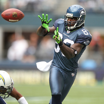SEATTLE - SEPTEMBER 26:  Wide receiver Deion Branch #83 of the Seattle Seahawks makes a catch against Donald Strickland #30 of the San Diego Chargers at Qwest Field on September 26, 2010 in Seattle, Washington. The Seahawks defeated the Chargers 27-20. (P