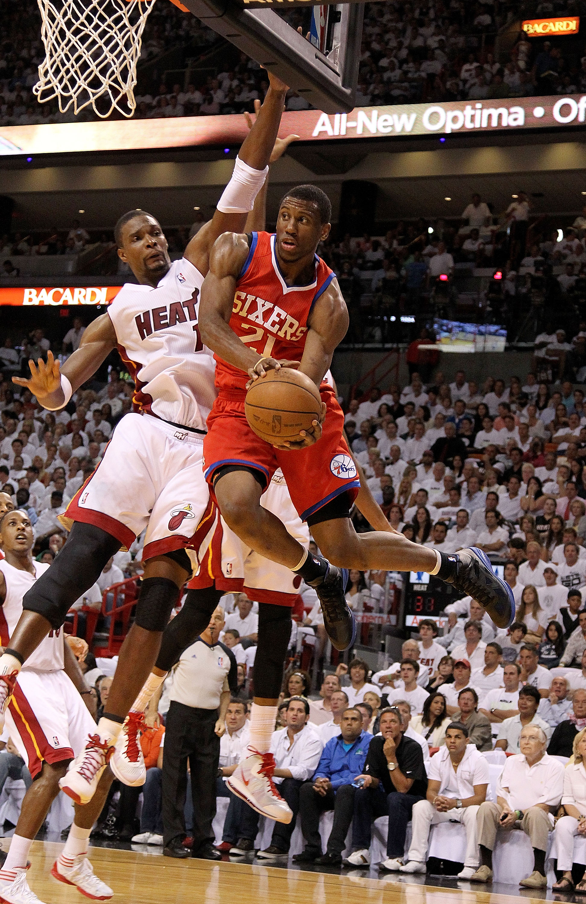 MIAMI, FL - APRIL 27:  Thaddeus Young #21 of the Philadelphia 76ers drives past Chris Bosh #1 of the Miami Heat during game five of the Eastern Conference Quarterfinals in the 2011 NBA Playoffs at American Airlines Arena on April 27, 2011 in Miami, Florid