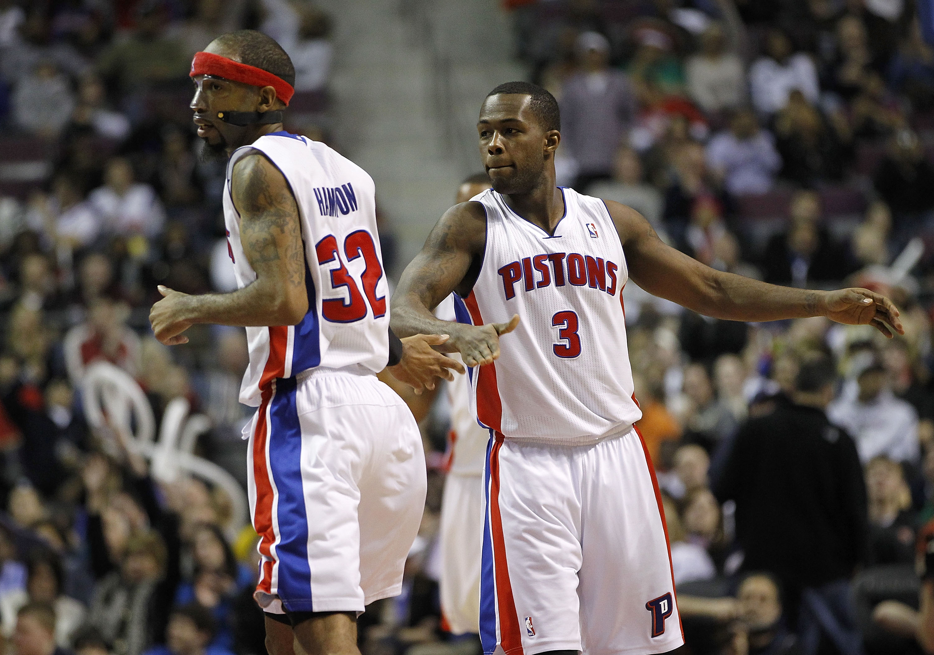 AUBURN HILLS, MI - MARCH 23:  Richard Hamilton #32 of the Detroit Pistons celebrates a three-point basket with teammate Rodney Stuckey #3 while playing the Miami Heat at The Palace of Auburn Hills on March 23, 2011 in Auburn Hills, Michigan. Miami won the