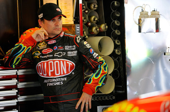 FORT WORTH, TX - APRIL 08:  Jeff Gordon, driver of the #24 DuPont Chevrolet, stands in the garage during practice for the NASCAR Sprint Cup Series Samsung Mobile 500 at Texas Motor Speedway on April 8, 2011 in Fort Worth, Texas.  (Photo by Jared C. Tilton