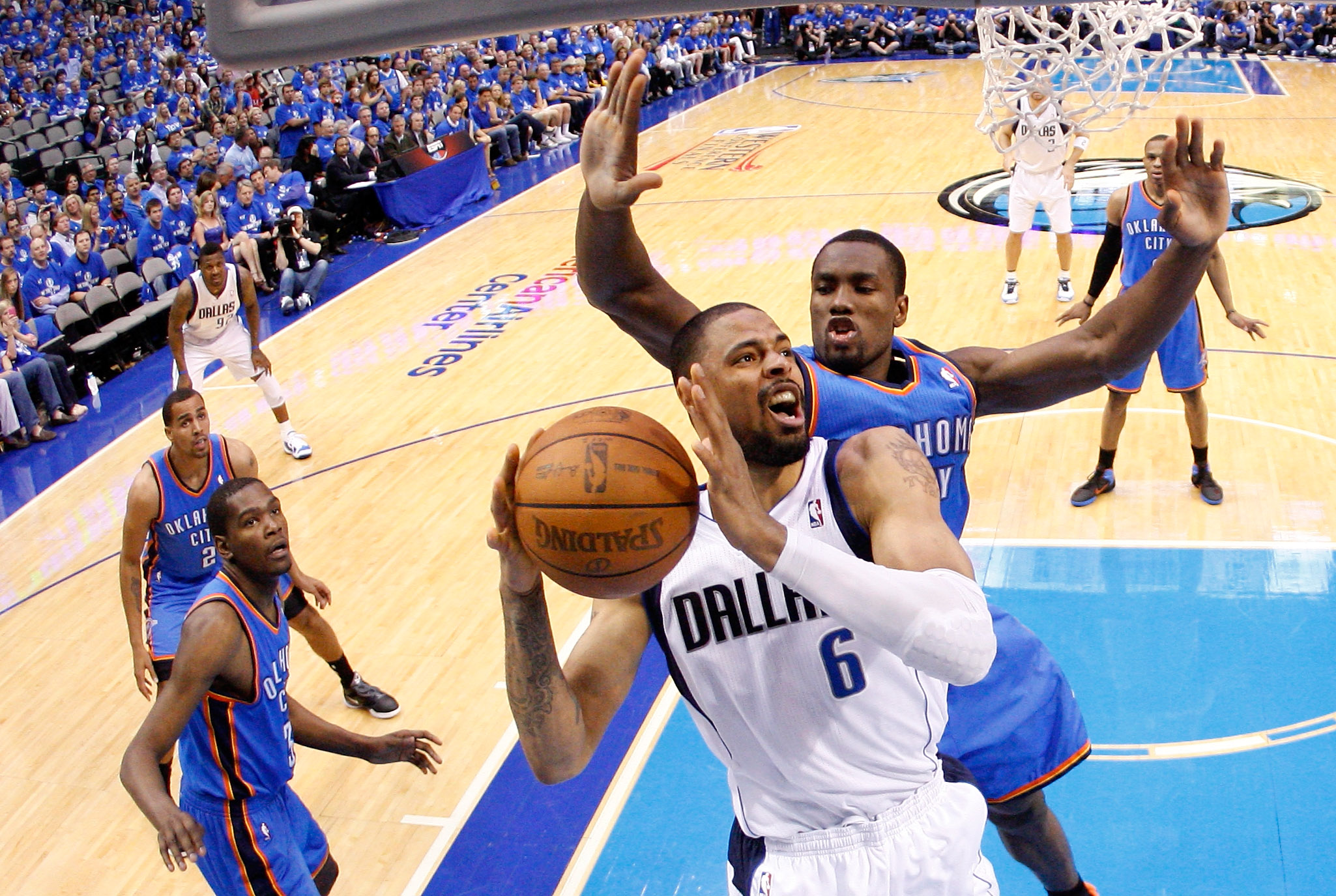 DALLAS, TX - MAY 25:  Tyson Chandler #6 of the Dallas Mavericks looks to go up for a shot in front of Serge Ibaka #9 of the Oklahoma City Thunder in the second half in Game Five of the Western Conference Finals during the 2011 NBA Playoffs at American Air