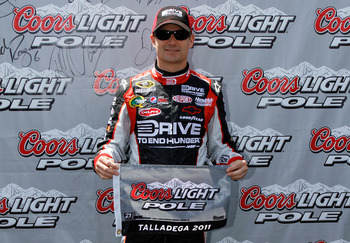 TALLADEGA, AL - APRIL 16:  Jeff Gordon, driver of the #24 Drive to End Hunger/AARP Chevrolet, poses after qualifying for the pole position in the NASCAR Sprint Cup Series Aaron's 499 at Talladega Superspeedway on April 16, 2011 in Talladega, Alabama.  (Ph