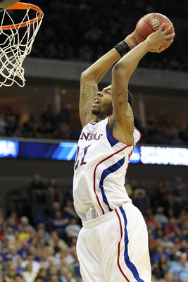 TULSA, OK - MARCH 20:  Markieff Morris #21 of the Kansas Jayhawks goes up for a dunk against the Illinois Fighting Illini during the third round of the 2011 NCAA men's basketball tournament at BOK Center on March 20, 2011 in Tulsa, Oklahoma.  (Photo by Ro