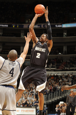WASHINGTON, DC - FEBRUARY 5:  Marshon Brooks #2 of the Providence Friars takes a jump shot over Chris Wright #4 of the Georgetown Hoays during a college basketball game on February 5, 2011 at the Verizon Center in Washington, DC.  The Hoyas won 83-81.  (P