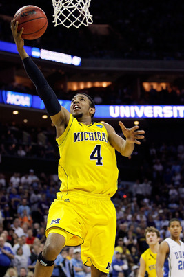 CHARLOTTE, NC - MARCH 20:  Darius Morris #4 of the Michigan Wolverines lays the ball up while taking on the Duke Blue Devils during the third round of the 2011 NCAA men's basketball tournament at Time Warner Cable Arena on March 20, 2011 in Charlotte, Nor