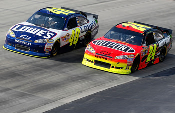 DOVER, DE - MAY 15: Jimmie Johnson, driver of the #48 Lowe's Chevrolet, races Jeff Gordon, driver of the #24 Dupont Chevrolet, during the NASCAR Sprint Cup Series FedEx 400 Benefiting Autism Speaks at Dover International Speedway on May 15, 2011 in Dover,