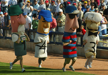 PHOENIX - MARCH 05:  Fans compete in the sausage race during a break from action at the MLB spring training game between the Oakland Athletics and the Milwaukee Brewers at Maryvale Baseball Park on March 5, 2005 in Phoenix, Arizona.  The Brewers won 3-1.