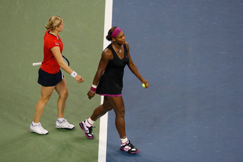 NEW YORK - SEPTEMBER 12:  Serena Williams (R) walks away from Kim Clijsters of Belgium after Williams was disqualified for a conduct violation towards a line judge during the Women's Singles Semifinal match on day thirteen of the 2009 U.S. Open at the UST