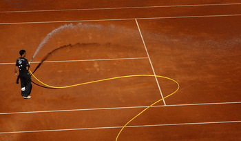 ROME - MAY 07:  A court attendant waters the dusty clay court in between games during day four of the Sony Ericsson WTA Tour Internazionli BNL D'Italia event at Foro Italico on May 7, 2009 in Rome, Italy.  (Photo by Ryan Pierse/Getty Images)