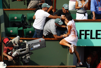 PARIS - JUNE 05:  Francesca Schiavone of Italy celebrates with her team after winning the women's singles final match between Francesca Schiavone of Italy and Samantha Stosur of Australia on day fourteen of the French Open at Roland Garros on June 5, 2010