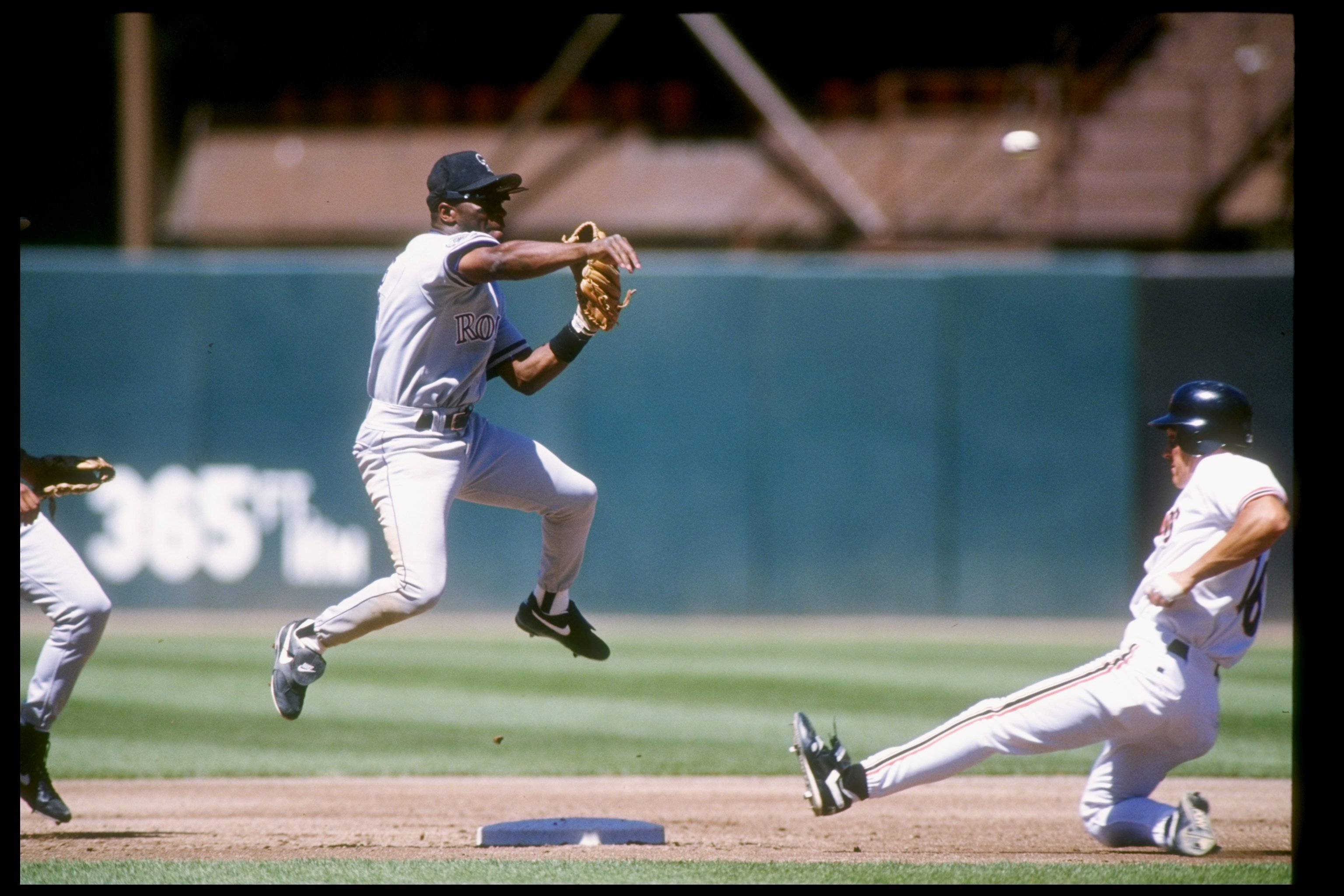 24 Jun 1993:  Infielder Eric Young of the Colorado Rockies tries to tag out M. Benjamin of the San Francisco Giants at Candlestick Park in San Francisco, California. Mandatory Credit: Otto Greule  /Allsport