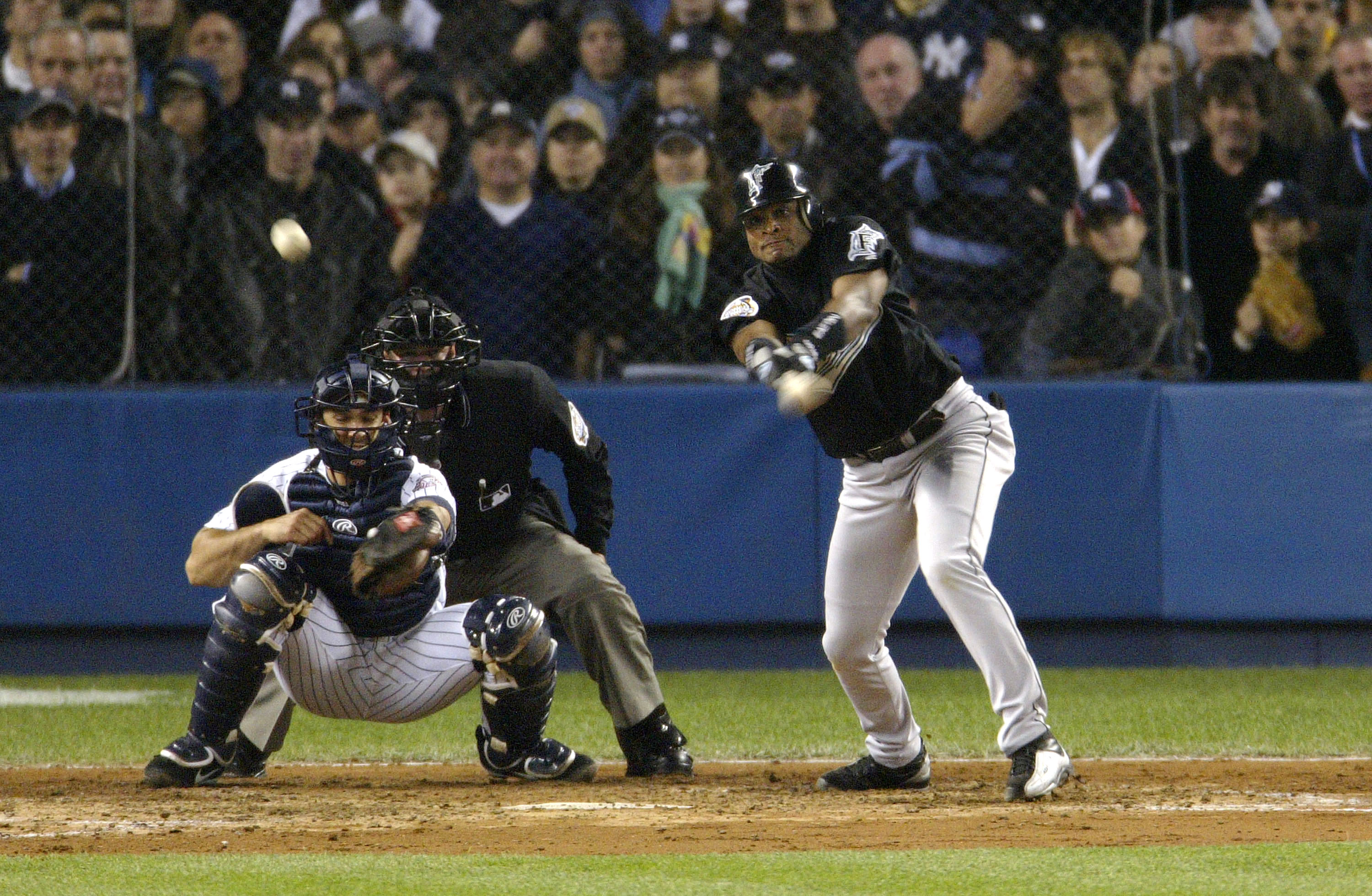 BRONX, NY - OCTOBER 25:  Luis Castillo #1 of the Florida Marlins hits an RBI single to score teammate for Alex Gonzalez in the fifthe inning during game six of the Major League Baseball World Series on October 25, 2003 at Yankee Stadium in the Bronx, New