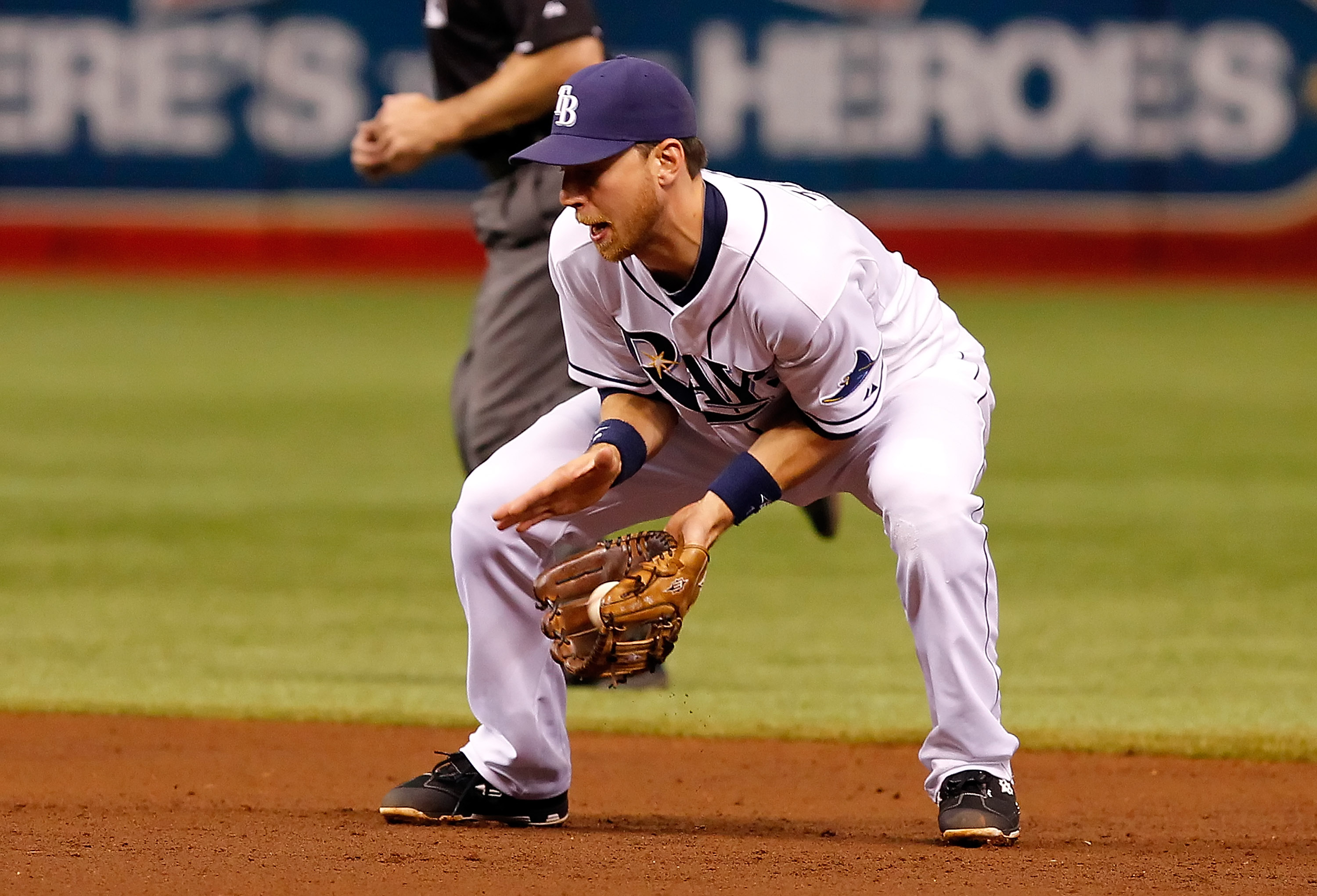 ST. PETERSBURG, FL - MAY 31:  Infielder Ben Zobrist #18 of the Tampa Bay Rays fields a ground ball against the Texas Rangers during the game at Tropicana Field on May 31, 2011 in St. Petersburg, Florida.  (Photo by J. Meric/Getty Images)