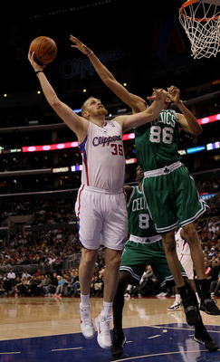 LOS ANGELES, CA - FEBRUARY 26:  Chris Kaman #35 of the Los Angeles Clippers shoots over Chris Johnson #86 of he Boston Celtics at Staples Center on February 26, 2011  in Los Angeles, California.  NOTE TO USER: User expressly acknowledges and agrees that,