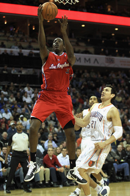 CHARLOTTE, NC - MARCH 07:  Al-Farouq Aminu #3 of the Los Angeles Clippers drives to the basket against Eduardo Najera #21 of the Charlotte Bobcats during their game at Time Warner Cable Arena on March 7, 2011 in Charlotte, North Carolina. NOTE TO USER: Us
