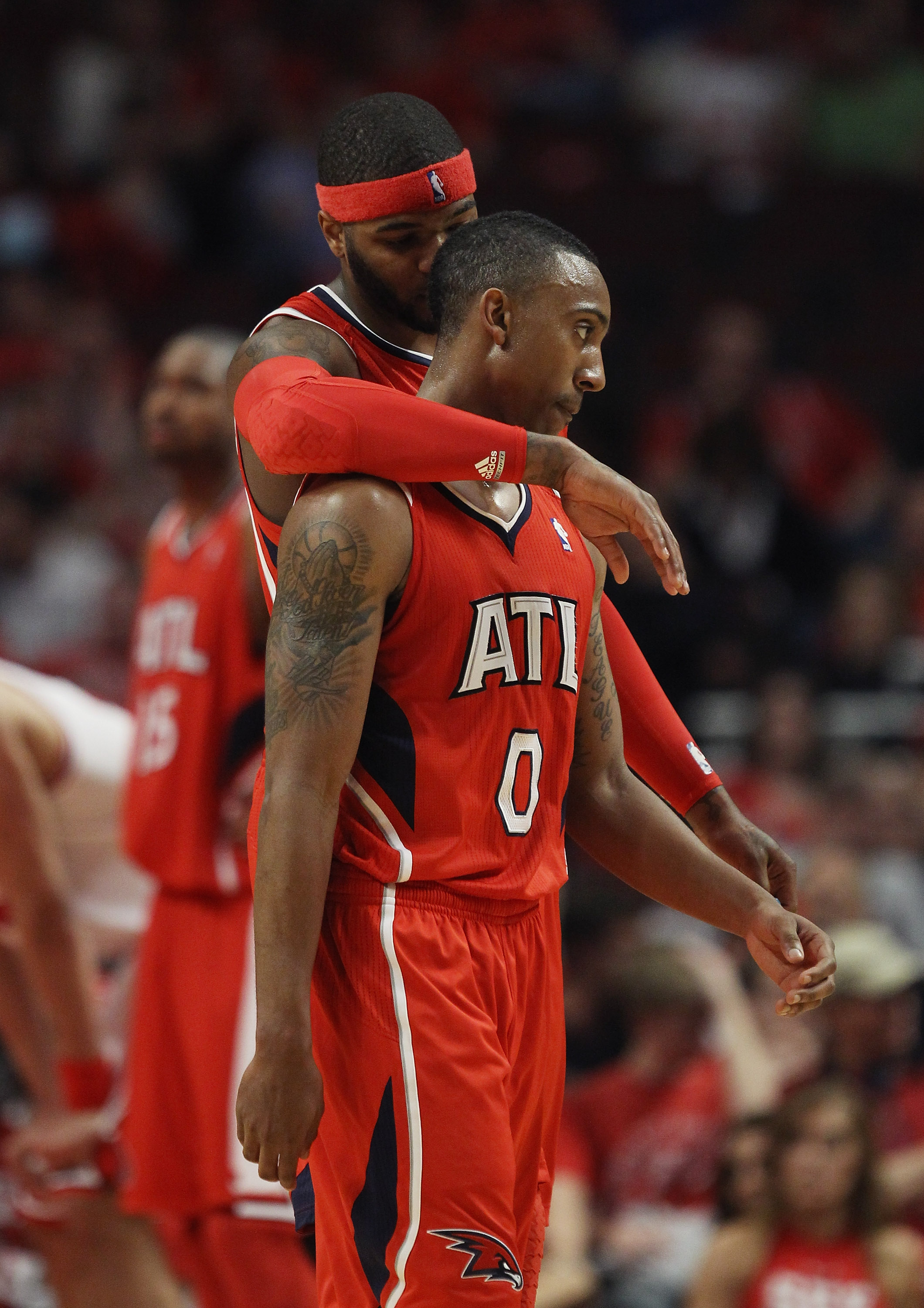 CHICAGO, IL - MAY 02: Josh Smith #5 of the Atlanta Hawks hugs teammate Jeff Teague #0 in the closing minute of a win over the Chicago Bulls in Game One of the Eastern Conference Semifinals in the 2011 NBA Playoffs at the United Center on May 2, 2011 in Ch